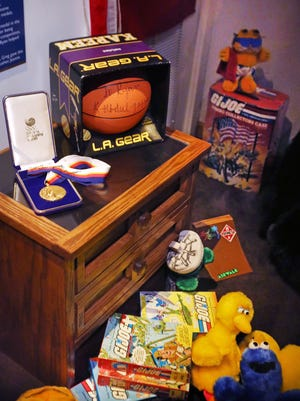 "Personal items that belonged to Ryan White are displayed in ""Ryan's Room"" in the ""Power of Children"" gallery at the Children's Museum of Indianapolis on Monday, Oct. 26, 2015. The museum hosted the Stand Up Against Bullying summit for students in grades 5-8. ""Ryan's Room"" is a re-creation of White's bedroom filled with his bed, posters, possessions and other mementos from his life. The basketball was a gift from Kareen Abdul Jabbat. White, who died from complications of HIV-AIDS in 1990, contracted the disease through a tainted blood treatment in the 1980s."