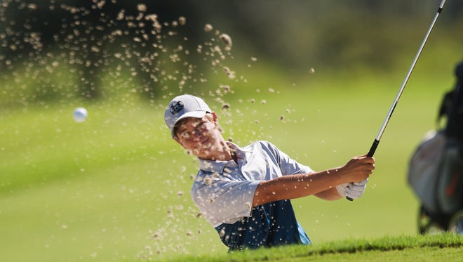 Estero resident Luke Farmer hits out of a bunker during the Nolan Henke-Patty Berg Junior Masters at River Hall Country Club. He sits in second place after the first round on Wednesday, July 20, 2016.