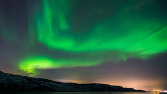 The Aurora Borealis, also known as the Northern Lights, above Kirkenes, Norway.