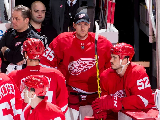 Detroit goalie Jimmy Howard sits on the bench in the