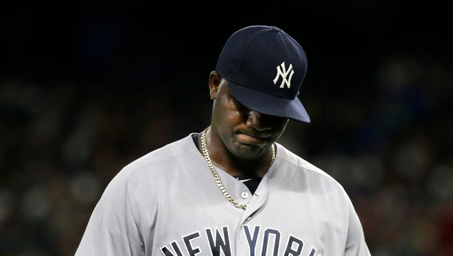 New York Yankees starting pitcher Michael Pineda walks to the dugout after he was pulled in the sixth inning of a baseball game against the Seattle Mariners, Monday, Aug. 22, 2016, in Seattle.