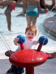 Max Hudson, 2 1/2 plays at Splash Town at the Smyrna Outdoor Adventure Center pool, on Wednesday June 28, 2017, in Smyrna, Tenn.