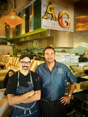 Chefs Julien Gremaud, at right, and Adam Brown at Avocado Grill in downtown West Palm Beach. Gremaud welcomed Brown, formerly chef at The Cooper restaurant in Palm Beach Gardens, to his culinary team on Tuesday, Feb. 11.