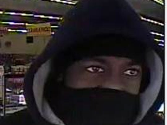 Police are working to identify a masked gunman they say robbed a Family Dollar on Gallatin Pike.