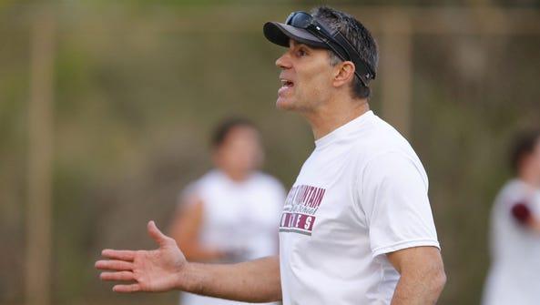 Former NFL star Kurt Warner leads spring football practice