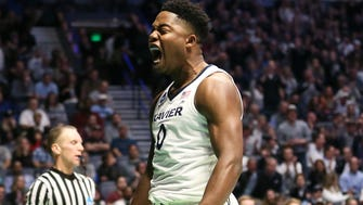 Xavier Musketeers forward Tyrique Jones (0) reacts after making a basket and getting fouled in the second half.