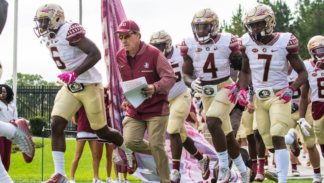 Florida State head coach Jimbo Fisher leads the Seminoles out of the tunnel against Duke at Wallace Wade Stadium.