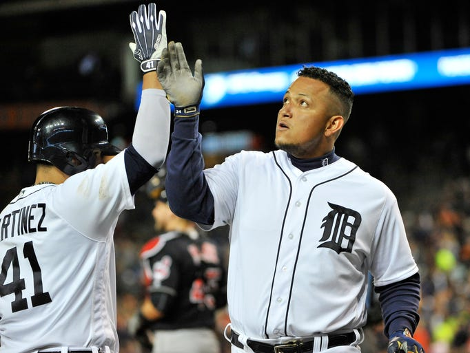 Detroit  Tigers' Victor Martinez, left, congratulates