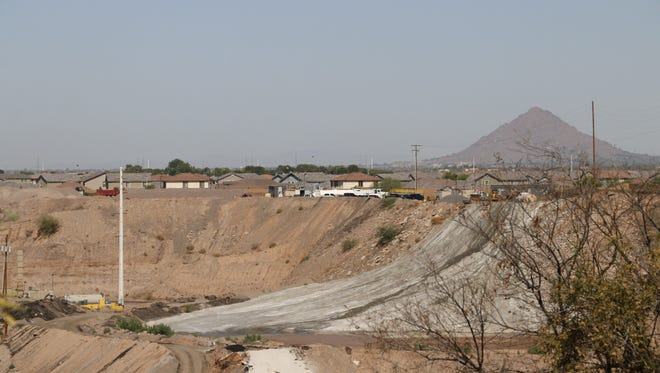 A Vulcan Materials Company mine can be seen nearby the residential neighborhood on June 22, 2018.