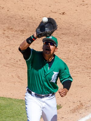 Mar 17, 2017; Lakeland, FL, USA; Tigers first baseman Efren Navarro catches a pop fly hit by the Yankees' Ruben Tejada in the seventh inning during spring training at Joker Marchant Stadium.
