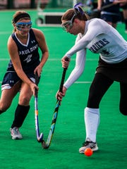 Spaulding #4 Makayla Boisvert and Bellows Falls #4 Dani Marchica clash during the DII field hockey championship on Saturday, Nov. 4, 2017 at UVM. Bellows Falls dominated the game, winning 6-0.