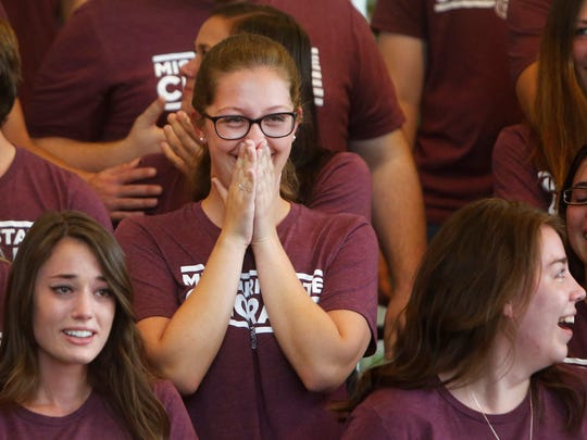 Courtney Grigg, center, and other members of the Missouri State Chorale react after Sen. Roy Blunt announced that they will be performing at the Presidential Inauguration in Washington, D.C. during a press conference at Juanita K. Hammons Hall for the Performing Arts on Friday, October 7, 2016.