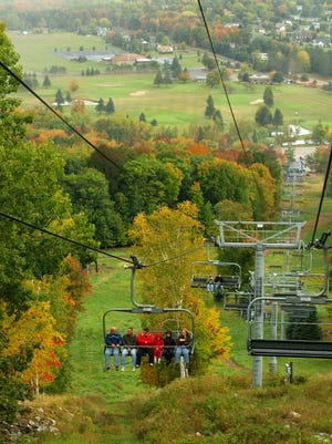 Visitors to Granite Peak can ride the ski lift to take in fall colors.