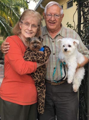 Maxie and DD with their new owners, Joan and Donald Herzig