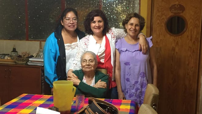 """María """"Toñita"""" Antonieta Fernández (bottom center) with her daughters, Reyna (center top) and Marisa Osuna (right), and caregiver Lidia Rodriguez (left), at home in Mexico City."""
