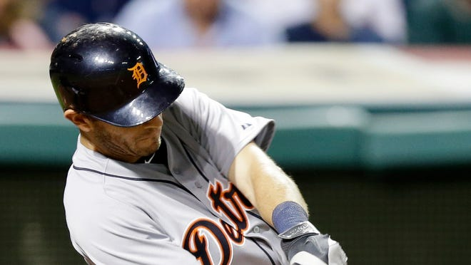Detroit Tigers' Ian Kinsler hits an RBI-double off Cleveland Indians relief pitcher Carlos Carrasco in the ninth inning.