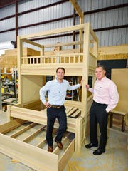 Joe Sinkovich and Tip McAlpin of The Armored Frog with a soon to be 10 foot custom bunk bed.