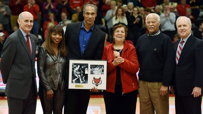 Marist College men's basketball program all-time leading scorer Steve Smith, center left, was honored on Friday at the McCann Arena. Smith is joined by family and Marist College Athletics Director Tim Murray, left, and Marist College President Dennis Murray.