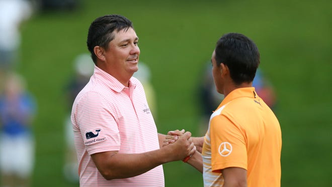Jason Dufner shakes hands with Rickie Fowler after the final round of The Memorial Tournament golf tournament at Muirfield Village Golf Club.