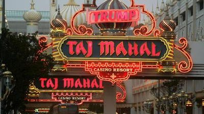 Hard Rock International and two New Jersey investors reached a deal to purchase the Trump Taj Mahal casino in Atlantic City.