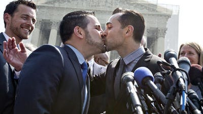 Paul Katami, right, kisses his partner Jeff Zarrillo, left, after asking to marry him, following the Supreme Court decision in Hollingsworth v. Perry, which cleared the way for the resumption of same-sex marriage in California, Wednesday, June 26, 2013