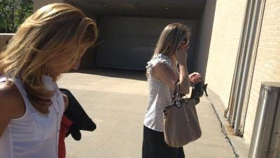 Rye teachers Carin Mehler and Dana Coppola ( with bag) leave the federal courthouse Friday afternoon.