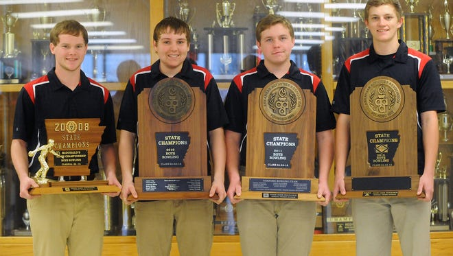 Norfork's bowlers who made all-state when the Panthers recently won the Class 1A-3A State Championship are shown holding all four of the school's boys' bowling state championship trophies, from 2008, 2010, 2011 and 2015. From left are: Collin Landry, Mason Rosson, E.J. Rogers and Austin Stinnett.
