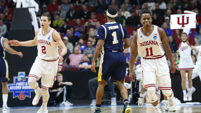 Indiana's Yogi Ferrell was plenty satisfied with the Hoosiers' performance Thursday against Chattanooga. He'll take on Tyler Ulis and Kentucky on Saturday.