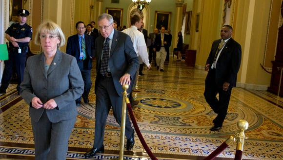 Senate Majority Leader Harry Reid, D-Nev. follows Sen.