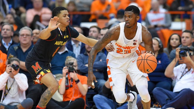 Syracuse Orange guard Frank Howard (23) drives to the basket against the defense of Maryland Terrapins guard Anthony Cowan (1) during the first half at the Carrier Dome.