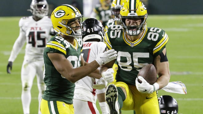 Green Bay Packers' Robert Tonyan (85) celebrates a touchdown reception with Malik Taylor (86) during the first half of an NFL football game against the Atlanta Falcons, Monday, Oct. 5, 2020, in Green Bay, Wis.
