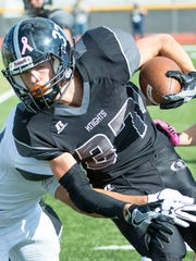 Oñate High School's Jake Elmore runs with the ball as the Knights take on La Cueva High School on Saturday, November 12, 2016, during the first round of the Class 6A state football playoffs at The Field of Dreams.