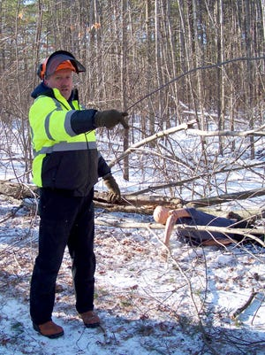 Dana Hinkley, instructor of Logger Rescue Training, gestures to the group during a logging accident training scenario with the Pittsville Fire Department in Vesper, Wisconsin, December 15, 2016.
