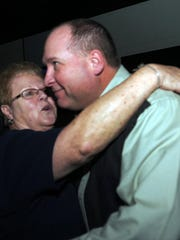 NOVEMBER: Newly elected Door County Sheriff Steve Delarwelle gets a hug from his mother, Gayle Gulley of Forestville, during reception in Sturgeon Bay.