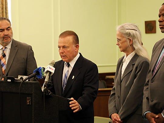 Sen. Joseph Pennacchio, at podium, speaks at a Statehouse