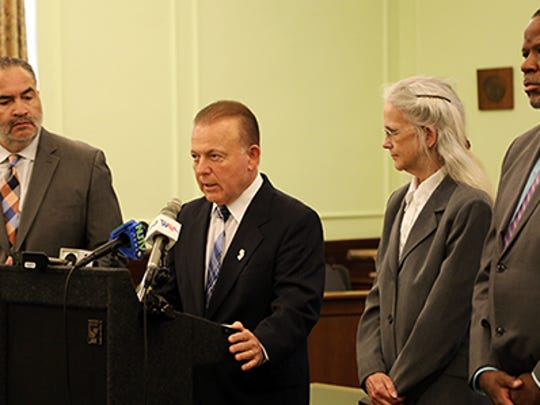 Sen. Joseph Pennacchio, at podium, speaks at a Statehouse press conference to push a bill that would help exonerate wrongfully convicted people in Trenton on Oct. 5, 2017.