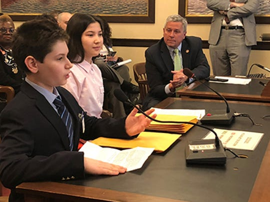 Princeton students Avi Weiss (left) and Vita Moss-Wang (center) joined state Sen. Kip Bateman at the March 26 Senate State Government Committee Hearing to testify in support of his bill to designate the bog turtle as New Jersey's Official State Reptile.