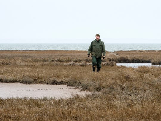 Eric Sherry stands in the Valentines area, where he has been working to restore the natural processes of the wetlands. The effort requires plugging the man-made ditches and performing vegetation surveys as the hydrology is altered.