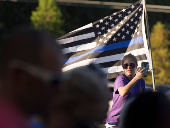 A flag supporting law enforcement personnel is held