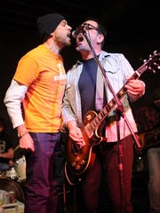 Scott Miller, left, joins his old V-Roy bandmate Mic Harrison for the chorus of 'Amy 88' on the second day of the Waynestock benefit event Friday, Jan. 28, 2011 at the Relix Variety Theatre, 1208 N. Central Avenue. The three-day festival celebrates the life of the late Andrew Bledsoe, the son of News Sentinel writer Wayne Bledsoe.