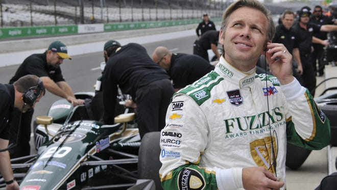 While his crew prepares the car for its initial laps during testing at the Indianapolis Motor Speedway on May 3, 2015, driver Ed Carpenter ponders whether he can be the polesitter for three years in a row.