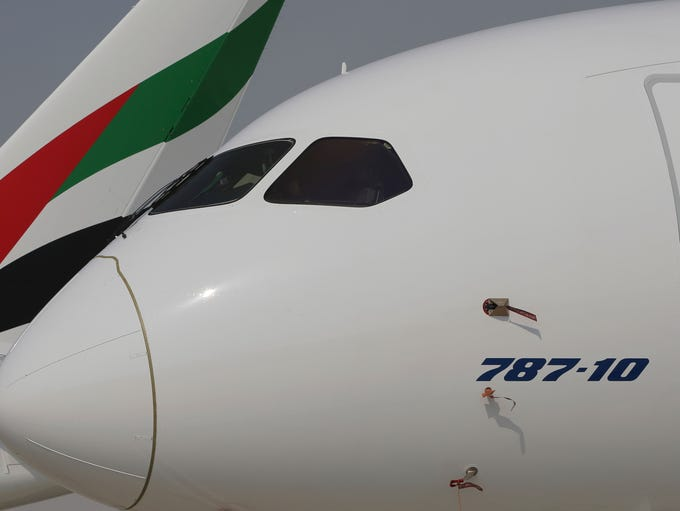 A Boeing 787-10 Dreamliner is parked in front of an