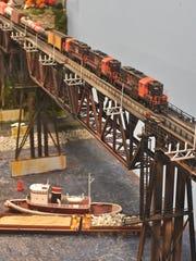 A model freight train heads across the Poughkeepsie