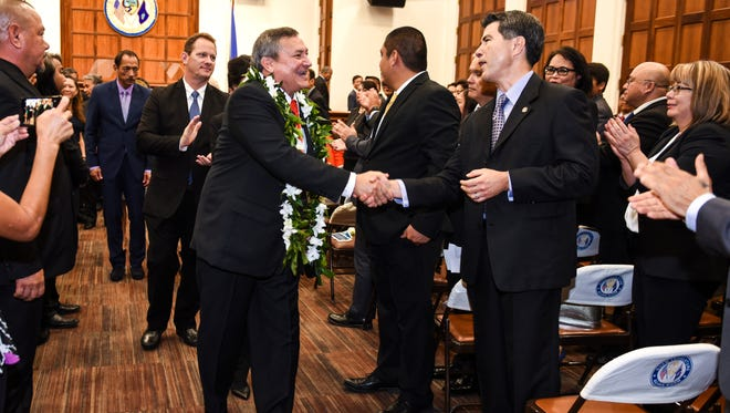 Gov. Eddie Calvo is applauded after delivering his last State of the Island Address to lawmakers and others at the Guam Legislature on Tuesday, Feb. 13, 2018.