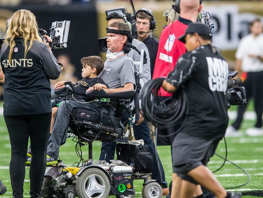 Steve Gleason is  part of the coin toss to start the
