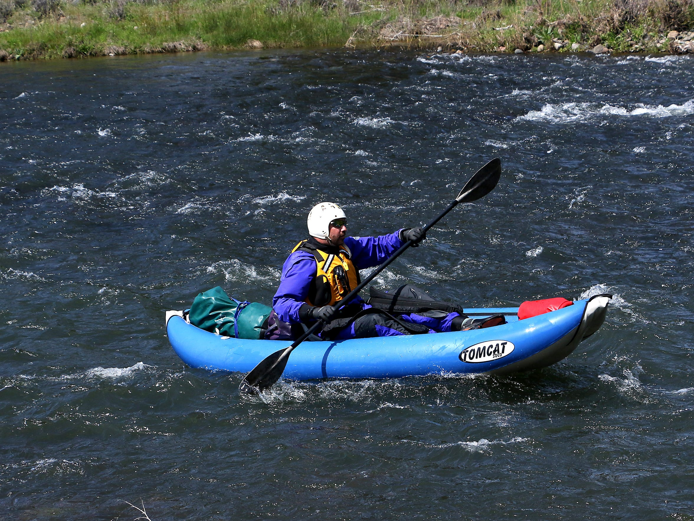 RGJ reporter Benjamin Spillman paddling the Truckee River in an inflatable kayak. Spillman and videographer Jason Bean paddle the Truckee River from Truckee to Pyramid Lake during May of 2016.