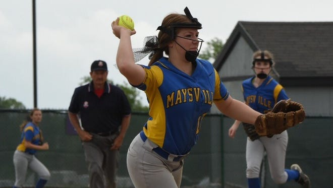 Maysville senior shortstop Kaylie Farmer throws to third after nabbing a hard hit ground ball during the regional semifinal game against Carrollton. The Panthers won 2-1 thanks to a two-run homer from Farmer in the third inning.