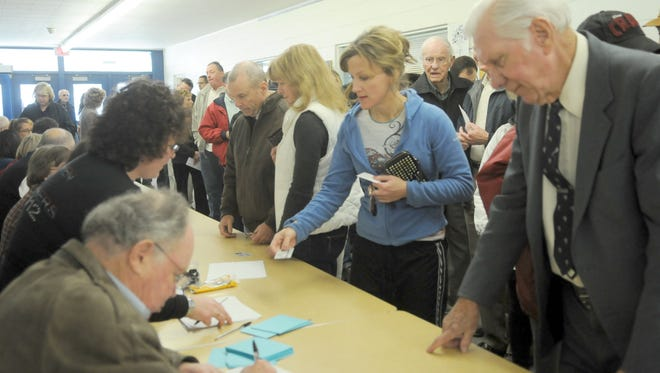 Voters register for the caucus at Swope Middle School Saturday Feb. 3, 2012. Marilyn Newton/RGJ