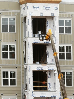 A worker fell to his death on March 24 from a fifth-floor balcony of Aspen Springfield, an apartment complex marketed to college students that was under construction at the time.