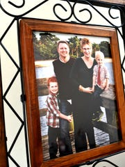 Family photo inside home of Amber Grider, her husband Craig, and two children, Devon and Riley.